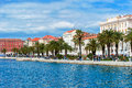 Residents and tourists walking along the shore in split largest city on coast croatia with historical part of town Royalty Free Stock Photography