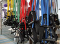 Resistance bands gym color coded to weight hanging in a setting Royalty Free Stock Images