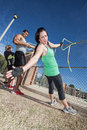 Resistance bands workout three adults using in outdoor fitness class Royalty Free Stock Photography