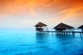Resort maldivian houses sunrise Stock Photo