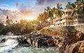 Resort near the ocean at lighthouse and sunset background in tropical kovalam kerala india Royalty Free Stock Photo