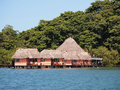 Resort over the water with thatched roof Royalty Free Stock Photography