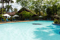 Resort s swimming pool with nobody in the tropics and area Royalty Free Stock Photography