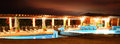 Resort swimming pool at night panoramic view of spanish hotel illuminated Royalty Free Stock Photos