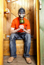 Respirator protects visitor of wc from stinky smell in finland Stock Image