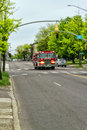 Responding to an alarm firetruck barreling down the street respond Royalty Free Stock Photography