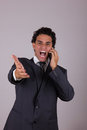 Responsible businessman while he talking on mobile Royalty Free Stock Images