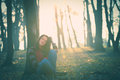 Rest in forest young woman casual clothes by tree retro colors Royalty Free Stock Images