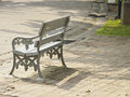 Rest grey bench for in park in afternoon time of sunny day Stock Photography