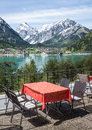 Restaurant in austria table and chairs at a cafe achensee Royalty Free Stock Photography