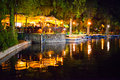 Restaurant in cismigiu park at night reflecting lake Royalty Free Stock Photography