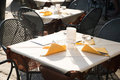 Restaurant exterior table white and yellow Stock Images