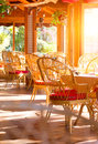 Restaurant interior. Summer coffee terrace with tables and wicker chairs Royalty Free Stock Photo