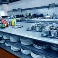 Restaurant kitchen motion chefs of a Royalty Free Stock Photo