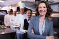Restaurant manager posing in front of team of staff Royalty Free Stock Photo