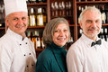 Restaurant manager posing with professional staff Royalty Free Stock Image