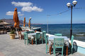 Restaurant on the sea shore in crete greece Stock Photos