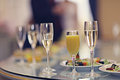 Restaurant serving juice champagne glasses Royalty Free Stock Photo
