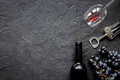 Restaurant set with wine bottle and grape on stone top view mock-up Royalty Free Stock Photo