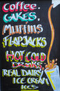 Restaurant sign coffee cakes mliffins flapjacks hot and cold drinks real dairy ice cream ices Royalty Free Stock Photo