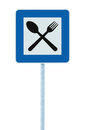 Restaurant sign post pole, traffic road roadsign, blue isolated dinner bar catering fork spoon roadside signage Royalty Free Stock Photo