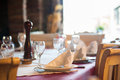 Restaurant table detail of a setup with white plates and glasses Royalty Free Stock Images