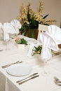 Restaurant table elegantly set for dining Royalty Free Stock Images