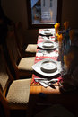 Restaurant table with plates Royalty Free Stock Images