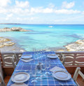 Restaurant table beside the sea Royalty Free Stock Images