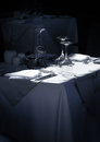 Restaurant table waiting for guests stylish with glasses and cutlery Stock Images