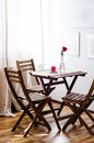 Restaurant table wooden chairs and in a Stock Photography