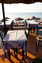Restaurant tables in Perissa, Santorini, Greece Royalty Free Stock Photo