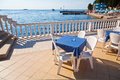 Restaurant tables in porec croatia and chairs at the adriatic coast Stock Images