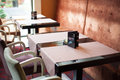 Restaurant tables by the window Royalty Free Stock Photo