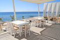 Restaurant tavern by the sea typical greek cafe on balcony aegean Royalty Free Stock Image