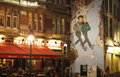 Restauraunt le platesteen in brussels february the evening by a wall painting the city of launched an Royalty Free Stock Photos
