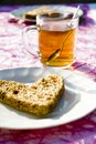 A restful afternoon tea with bread and teacups Stock Photos