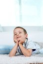 Restful boy adorable child lying on the floor and doing nothing Royalty Free Stock Photo