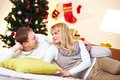 Restful couple portrait of happy husband and wife relaxing at home on christmas day Royalty Free Stock Images