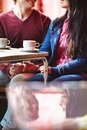 Restful dates happy young couple sitting by table in cafe Royalty Free Stock Images