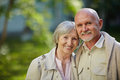 Restful seniors looking at camera in natural environemnt Royalty Free Stock Photography