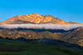 Resting cloud on the side of mountain to the entrance to yellowstone national park Stock Photo