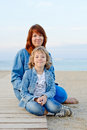 Resting family mother and daughter near the sea Royalty Free Stock Photography
