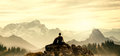 Resting hiker rests on mountain top while enjoying the view Royalty Free Stock Photography