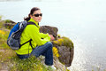 Resting hiker sitting on the stone Royalty Free Stock Photo