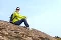 Resting hiker sitting on the stone Stock Photography