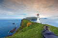 Resting after hiking at Mykines Lighthouse, Faroe Islands Stock Photography