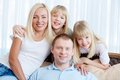 Resting at home portrait of happy couple with twin daughters Royalty Free Stock Image