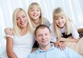 Resting at home portrait of happy couple with twin daughters Stock Photography