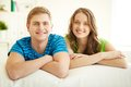 Resting at home portrait of happy young couple looking camera Royalty Free Stock Photos